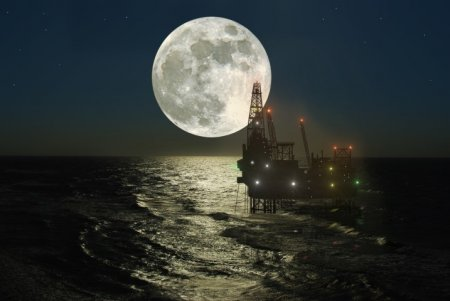 Oil platform and full moon