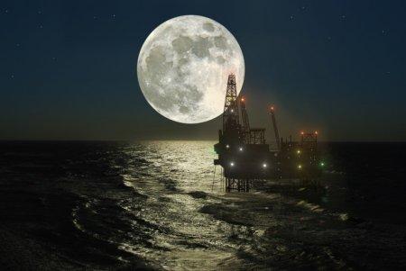 Oil platform and full moon